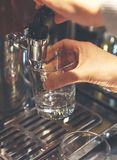 Woman pours a drink. Woman pours a drink in the diner with self-service Stock Photos