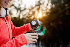 Woman pours hot tea into a mug from a thermos. Closeup Royalty Free Stock Photo
