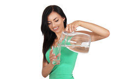 Woman pours water Stock Photos