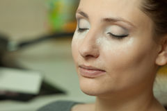Woman with powder dust on cheeks Royalty Free Stock Photography