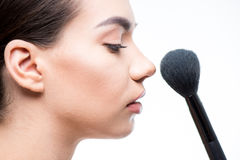 Woman powder face with brush Royalty Free Stock Image