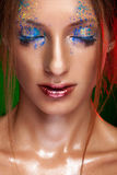 Woman with powder on face in creative make up style Stock Photos
