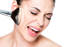 Woman with  powder on the skin of cheek. Face of a woman with  powder on the skin of cheek- isolated on white Stock Image