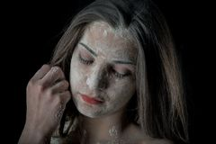 Woman with powder in the studio on a black background Royalty Free Stock Photo