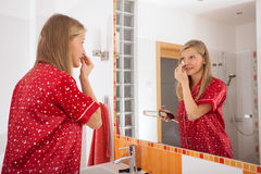 Woman powdering her face Stock Images
