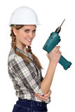Woman with a power drill Royalty Free Stock Photography