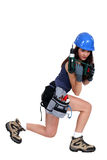 Woman with a power drill Royalty Free Stock Images