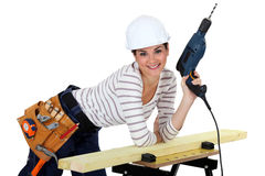 Woman with a power drill. Woman stood with a power drill Royalty Free Stock Photo