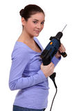 Woman with a power drill Stock Photography