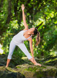 Woman Practacing Yoga in Nature Stock Image