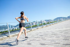 Woman practice running in a city Stock Photography