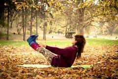 Woman practice yoga balance outdoor Royalty Free Stock Photo
