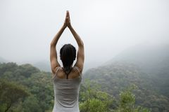 practice yoga on foggy spring mountain top Stock Images