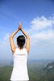 Woman practice yoga at mountain peak Royalty Free Stock Photos