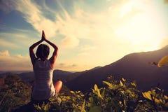 Woman practice yoga at mountain peak Royalty Free Stock Image