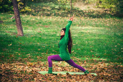 Woman practice yoga outdoor Stock Image
