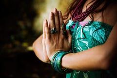 Woman practice yoga outdoor. Close up of hands in namaste gesture Stock Photos