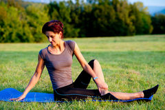Woman practice yoga outdoor in park Royalty Free Stock Image