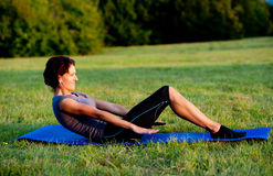 Woman practice yoga in park Stock Images