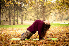 Woman practice yoga stretching outdoor Stock Photo