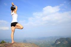Woman practice yoga at sunrise seaside Royalty Free Stock Images