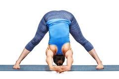 Woman practices Ashtanga Vinyasa yoga asana Prasarita padottanas. Beautiful sporty fit woman practices Ashtanga Vinyasa yoga asana Prasarita padottanasana C Royalty Free Stock Photography