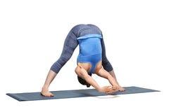 Woman practices Ashtanga Vinyasa yoga asana Prasarita padottanas. Beautiful sporty fit woman practices Ashtanga Vinyasa yoga asana Prasarita padottanasana C Stock Photography