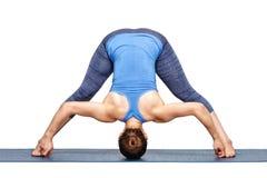 Woman practices Ashtanga Vinyasa yoga asana Prasarita padottanas. Beautiful sporty fit woman practices Ashtanga Vinyasa yoga asana Prasarita padottanasana D Stock Photos