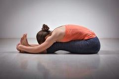 Woman practices Ashtanga Vinyasa yoga asana Royalty Free Stock Photography