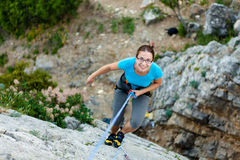 Woman climbing. Woman practices in climbing at the rock in the Crimea mountains Stock Image