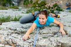 Woman climbing Stock Image
