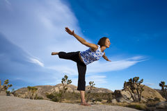 A woman practices Yoga. Stock Images