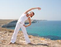 Woman practices Yoga Stock Photo