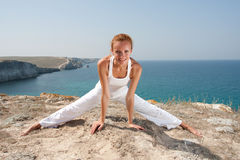 Woman practices Yoga Stock Images