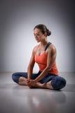 Woman practices yoga asana Baddha konasana Royalty Free Stock Photo