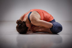 Woman practices yoga asana Baddha konasana. Beautiful sporty fit woman practices yoga asana Baddha konasana - bound angle pose Stock Photo