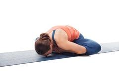Woman practices yoga asana Baddha konasana. Beautiful sporty fit woman practices yoga asana Baddha konasana - bound angle pose isolated on white Stock Images