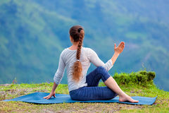 Woman practices yoga asana outdoors Stock Images