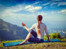 Woman practices yoga asana outdoors royalty free stock images