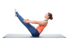 Woman practices yoga asana Paripurna navasana Royalty Free Stock Photography