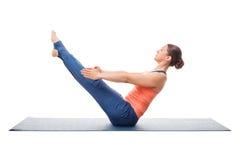 Woman practices yoga asana Paripurna navasana Royalty Free Stock Photography