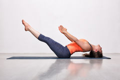 Woman practices yoga asana Uttana padasana Stock Photo