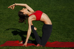 Woman practices yoga. beautiful bend. Woman practices yoga in nature Stock Photo