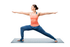 Woman practices yoga Warrior asana Royalty Free Stock Photography