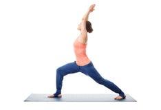 Woman practices yoga Warrior asana Stock Photography
