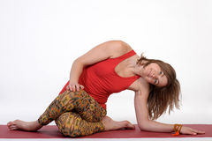 Woman practicing advanced yoga against isolated white studio paper background. Stock Image