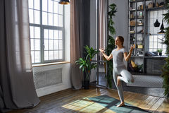 Woman practicing advanced yoga in the living room at home. A series of yoga poses.  stock photos