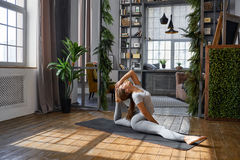 Woman practicing advanced yoga in the living room at home. A series of yoga poses.  stock images