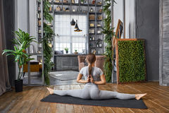 Woman practicing advanced yoga in the living room at home. A series of yoga poses Stock Photography