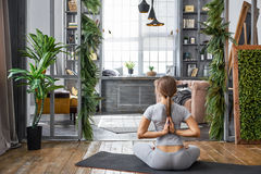 Woman practicing advanced yoga in the living room at home. A series of yoga poses Royalty Free Stock Photo